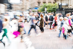 Crowd of people crossing a street with zoom effect Stock Photo