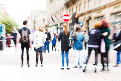 Crowd of people crossing a street with zoom effect Stock Photos