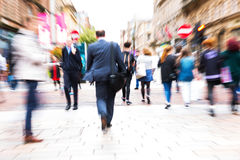Crowd of people crossing a street with zoom effect Royalty Free Stock Photos