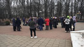 A crowd of people dance to the accompaniment of the bayan player in the city park during the religious holiday stock video footage