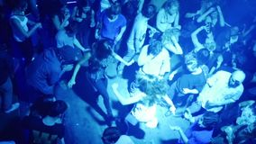 Crowd of people dancing in a club slow motion stock video footage