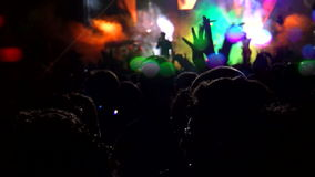 Crowd of people dancing at the concert stock footage