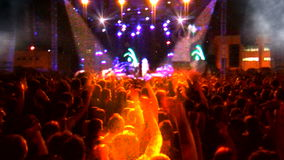 Crowd of people dancing at the concert stock video footage