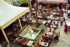 Crowd of people drinking coffee in outdoor cafe in popular touristic area of turkish capital Stock Photography