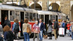 Crowd of people emerging from the Czech tram in Old City of the Czech Republic, Prague. Slow Motion. CZECH REPUBLIC, PRAGUE, SEPTEMBER 12, 2017: Crowd of people stock video