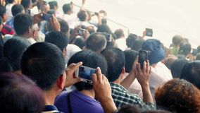 Crowd Of People Filming Event With Smartphones stock video footage