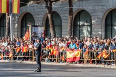 A crowd of people with flags in Spanish National Day Parade Royalty Free Stock Photography