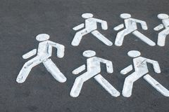 A crowd of people follow the leader. royalty free stock photos