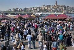 A crowd of people gather adjacent to Golden Horn in the Eminonu district of Istanbul in Turkey. A crowd of people gather adjacent to Golden Horn in the Eminonu royalty free stock photos