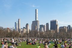 Crowd of people in Central Park New York City stock images
