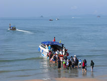 Thailand, tourists, sea trip, crowd of people. Thailand, Krabi, Ao Nang beach. Boarding on sea excursion. Crowd of people knee-deep in seawater stock photos