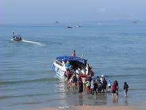Crowd of people knee-deep in seawater Stock Photos