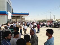 Crowd of people. Large crowd of people at a petrol station in hawler royalty free stock images