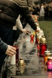 Crowd of people lighting candles in city center, mourning victim. S in terrorism attacks and revolutions, sadness moment Royalty Free Stock Images