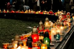 Crowd of people lighting candles in city center, mourning victim. S in terrorism attacks and revolutions, sadness moment Royalty Free Stock Photography