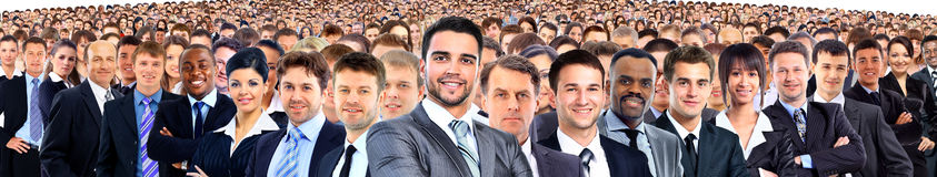 A crowd of people looking at the camera Stock Image
