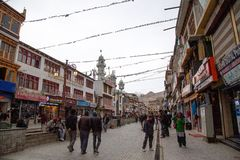 Crowd of people in Main Bazar market, Leh City, India. Leh, India : April 2019 - Crowd of people with Buddhist Tibetan prayer flag and lot of survinior shop on stock photos