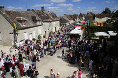 Crowd People  in medieval market Stock Images