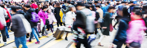 Crowd of people in motion blur crossing a street Stock Photography