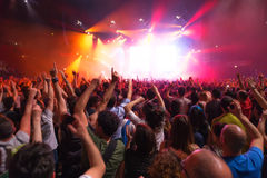 Crowd of people at music concert in front of the stage Stock Images