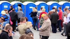 Crowd of people near outdoor public toilets Royalty Free Stock Photo