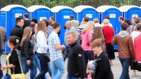 Crowd of people near public lavatory Stock Photography