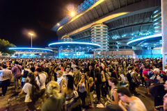 Crowd of people outside San Siro football stadium in Milan, Italy. MILAN, ITALY - july 2014: Crowd of people outside San Siro football stadium. Stadium is the stock images