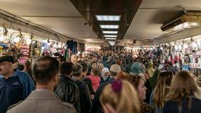 Crowd of people passing through Istanbul`s Eminonu quarter underground passage stock images