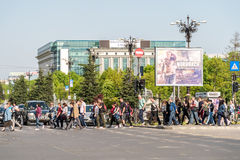 Crowd Of People Pedestrians Crossing Street. BUCHAREST, ROMANIA - MAY 14, 2015: Crowd Of People Pedestrians Crossing Street In Union Square (Piata Unirii) Royalty Free Stock Photo