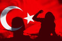 Turkey flag, crowd of people. Crowd of people with raised arms over blending Turkey flag stock photos