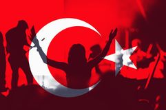 Turkey flag, crowd of people. Crowd of people with raised arms over blending Turkey flag stock images