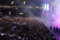 Crowd of people with raised hands at a concert Royalty Free Stock Images