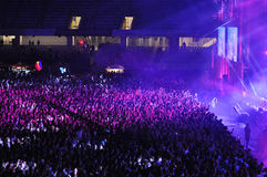Crowd of people with raised hands at a concert Stock Images