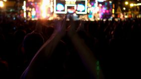 Crowd people raising hands and enjoying in music concert music festival stock footage