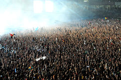 Crowd of people raising their hands at a concert Royalty Free Stock Image