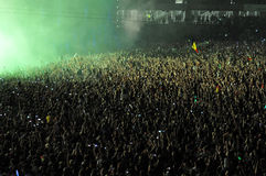 Crowd of people raising their hands at a concert Stock Photography