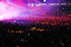 Crowd of people raising their hands at a concert Royalty Free Stock Photography