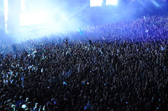 Crowd of people raising their hands at a concert Stock Image