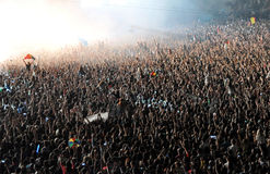 Crowd of people raising their hands at a concert Stock Images
