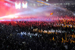 Crowd of people raising their hands at a concert Stock Photo