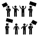 A crowd of people at a rally with placards. Royalty Free Stock Images