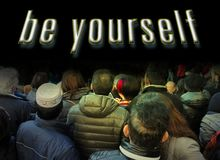 Crowd of people from the rear look at white `be yourself`  words. Encouragement concept. Royalty Free Stock Image
