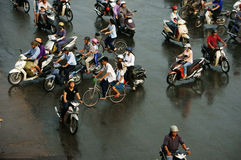 Crowd of people ride motorcycle in rush hour Stock Photos