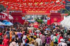 Crowd people roams the street Yaowarat during celebration Chinese New Year. Chinatown in Bangkok, Tha Stock Photo