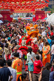 Crowd people roams the street Yaowarat during celebration Chinese New Year. Chinatown in Bangkok, Tha Royalty Free Stock Image