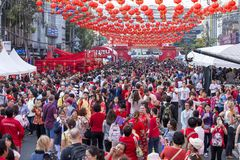 Crowd of people roams the street of Yaowarat during the celebration of Chinese New Year and Valentine`s Day. Yaowarat is a Chinat. BANGKOK, THAILAND - FEBRUARY Stock Photography