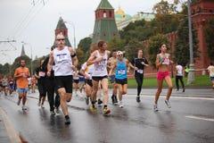 Crowd people run on Kremlin embankment Royalty Free Stock Photography
