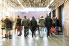 Crowd of people rushing through corridor, zoom effect, motion bl Royalty Free Stock Image