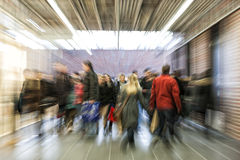 Crowd of people rushing through corridor, zoom effect, motion bl Royalty Free Stock Photos