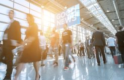 Blurred business people at a trade show. Crowd of people rushing on a floor at a trade show. ideal for websites and magazines layouts stock photography